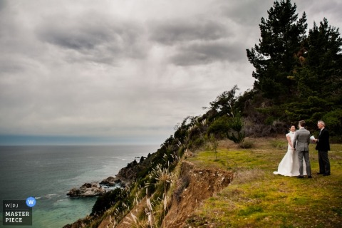 San Francisco wedding photographer captured this photo of a private ceremony in the woods on a beachside cliff