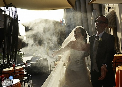 Umbria wedding photographer captured this unique portrait of the bride and groom as fog shrouds the patio where they are standing