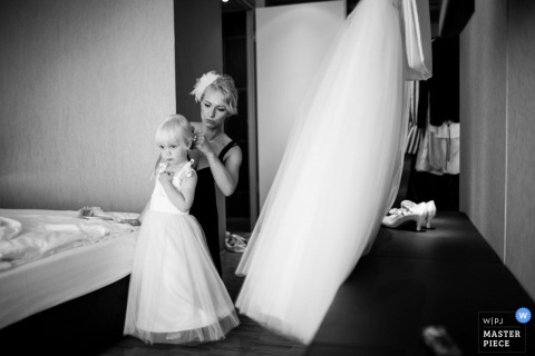 Lower Saxony Germany getting ready photo of bride helping flowergirl with her hair