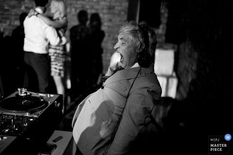 Victoria wedding photographer captured this black and white photo of the DJ yawning as he entertains the wedding guests late into the night
