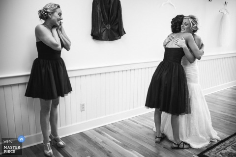 Charleston wedding photographer captured this black and white photo of the bride embracing her bridesmaid before the ceremony