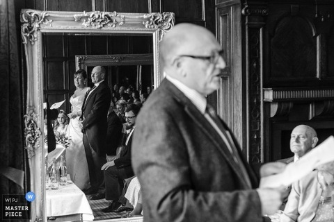 Newcastle wedding reportage photographer captured this black and white photo of the bride and grooms reflection during their vows
