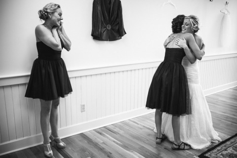 Wedding Photographer from South Carolina shooting black and white hugging photos after the ceremony.