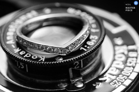 Taipei wedding photographer created this black and white image of the brides wedding band resting on top of a vintage camera lens