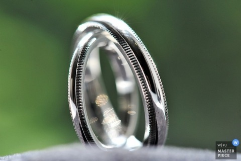 New York City wedding photographer captured this detail shot of the couples wedding bands shining in the light