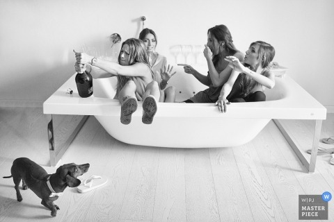 Arezzo Wedding Photography | Image contains: hot tub, getting ready, champagne, dog, black, white, bride, bridemaids