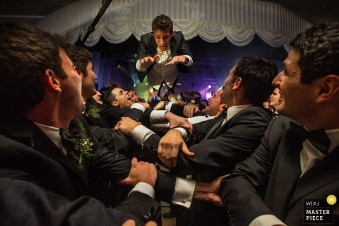 Madrid Wedding Photographer Image contains: groom, groomsmen, color, arms