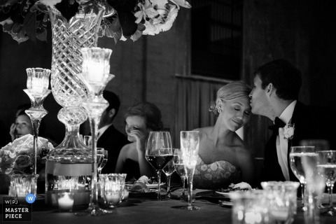 Seattle Documentary Wedding Photographer | Image contains: reception, black, white, couple, table, candles, vase, flowers