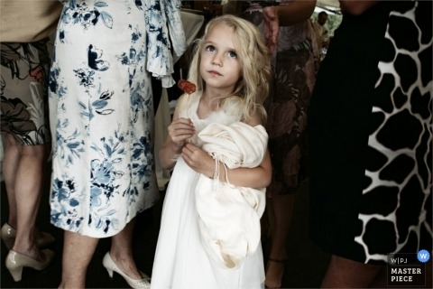 London Documentary Wedding Photographer   Image contains: flowergirl, wedding guests, color, indoors