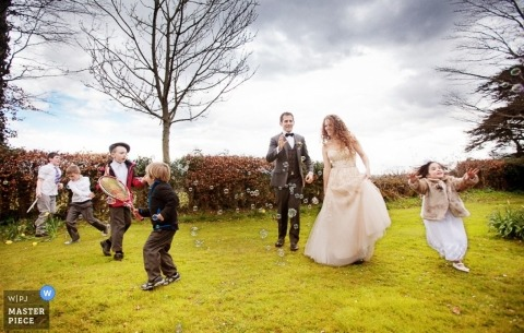 Overijssel Wedding Photographer | Image contains: outdoors, color, kids, grass, bride, groom