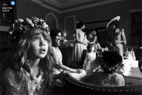 Documentary Wedding Photography in London   Image contains: flowergirl, getting ready, black, white, flowers, indoors