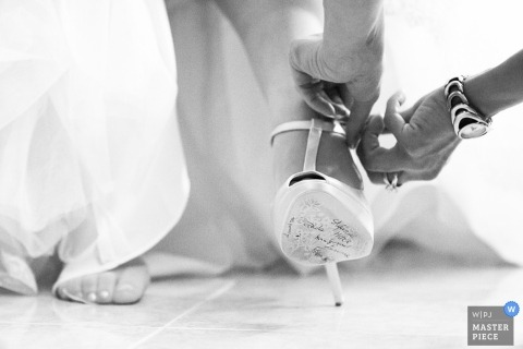 Rome Documentary Wedding Photographer | Image contains: shoe, feet, black, white, getting ready, watch, dress, bride