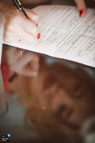 Charleston Wedding Photography | Image contains: paper, pen, color, bride, hands, reflection, table