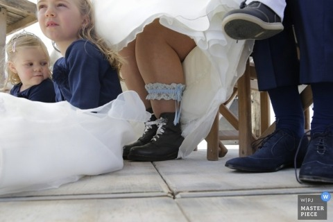 Noord Holland Documentary Wedding Photographer | Image contains: garter, flowergirls, shoes, dress, color