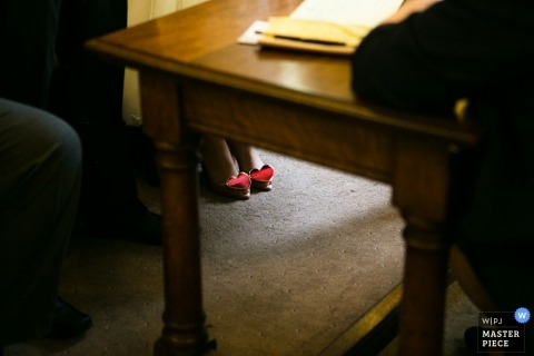 London Documentary Wedding Photographer | Image contains: color, hearts, shoes, table, papers