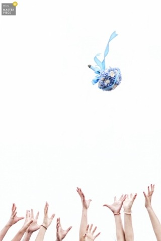 Documentary Wedding Photography in Zhejiang | Image contains: bouquet toss, color, sky, hands, arms,