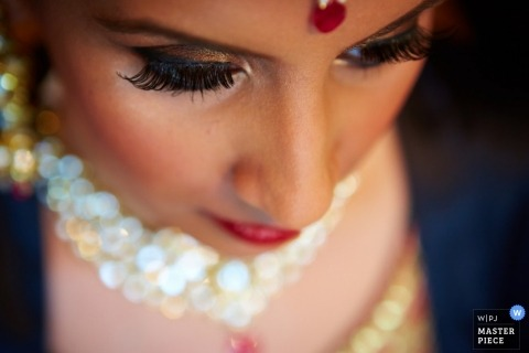 Wedding Photography in New Jersey | Image contains: makeup, bride, face, jewelry, color, getting ready