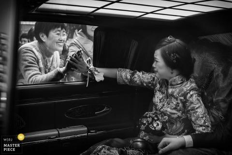 Hangzhou City Wedding Photographer Image contains: bride, black, white, car, mother, window, hands