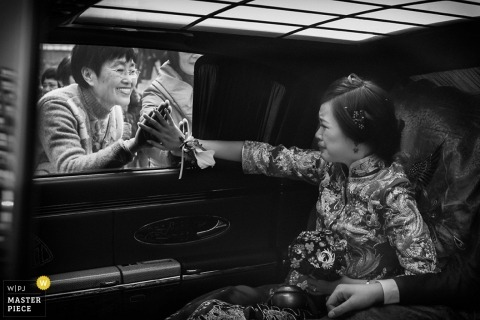 Hangzhou City Wedding Photographer Image contains: bride, black, white, car, mother, window, hands