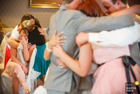 Hartford Wedding Photography | Image contains: hugs, crying, indoors, color, wedding guests