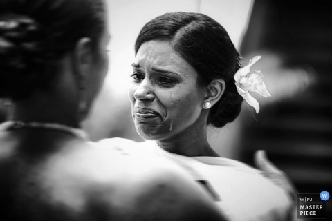 Wedding Photographer in Toronto | Image contains: bride, crying, black, white, indoors, flower
