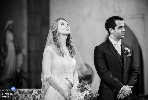 Wedding Photographer in Manhattan | Image contains: ceremony, church, bride, groom, flowers, indoors
