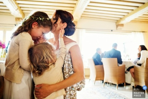 Wedding Photographer in Ljubljana | Image contains: bride, flowergirl, crying, indoors, reception, color