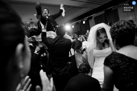 Houston Documentary Wedding Photographer | Image contains: reception, bride, groom, black, white, wedding guests