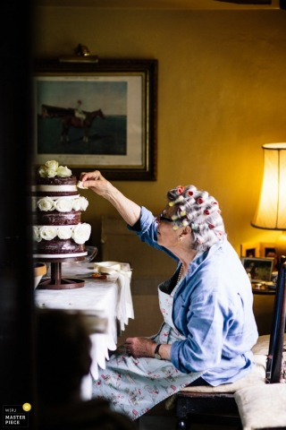 Wedding Photographer in Kent | Image contains: women, cake, curlers, getting ready, color