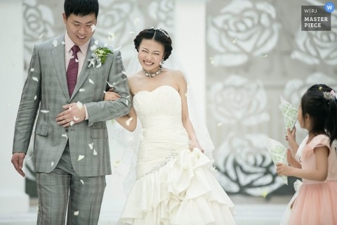 Documentary Wedding Photography in Tianjin   Image contains: chinese ceremony, flower petals, girl, bride, groom