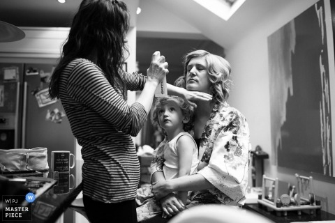 Documentary Wedding Photography in London | Image contains: getting ready, girl, bride, hairspray, black, white, kids, children, flowergirl