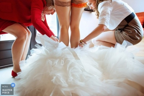 Bytom Documentary Wedding Photographer | Image contains: dress, color, garter, bride, women, getting ready