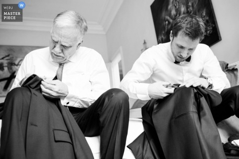 Wedding Photography in Paris | Image contains: black and white, groom, father, coats getting ready