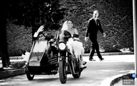 Bari Documentary Wedding Photographer   Image contains: motorcycle, sidecar, outdoor, couple, black, white, driveway, groomsman