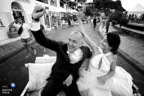 Reggio Calabria Wedding Photographer Image contains: couple, coach, street, city, black, white, ceremony
