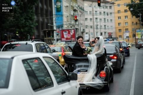 Wedding photograph from Sofia   Image contains: veil, city, outdoors, car, traffic, color, couple