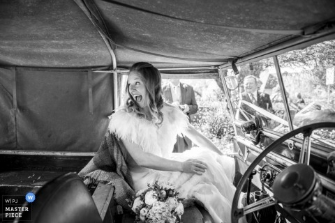 London Wedding Photographer Image contains: black, white, car, bride, flowers, dress
