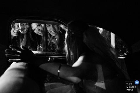 São Paulo Wedding Photographer   Image contains: wedding guests, car window, bride, black, white