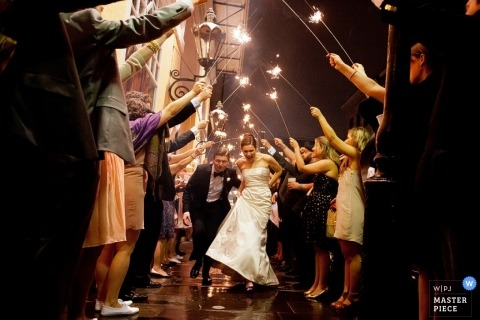 Los Angeles Wedding Photographer Image contains: sparklers, couple, street, wedding guests, color, exit, departure