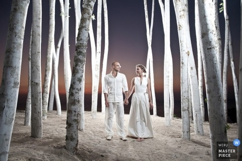 Wedding photograph from Bali | Image contains: white birch trees, couple, light, sunset, outdoors
