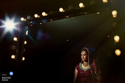 Wedding Photographer in Essex | Image contains: color, bride, lightbulbs, frame