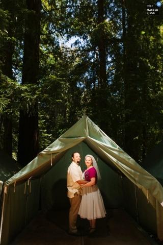 San Jose Wedding Photography | Image contains: portrait, tent, forest, color, bride, groom