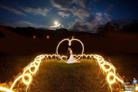 Zurich Wedding Photographer Image contains: sparklers, sunset, outdoors, portrait, couple, color
