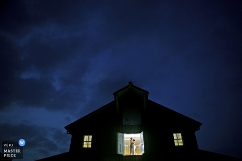 Documentary Wedding Photography in Knoxville | Image contains: portrait, sunset, blue, couple, barn, color