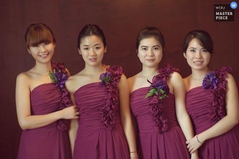 Wedding Photographer in Hangzhou City | Image contains: portrait, bridesmaids, purple, flowers, dresses