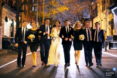 New York City Wedding Photography | Image contains: bride, groom, bridal party, downtown, city walk, portrait