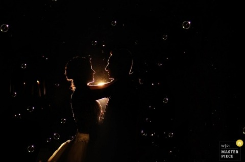 Italy Wedding Photographer | Image contains: first dance, groom, bride, color, silhoutte