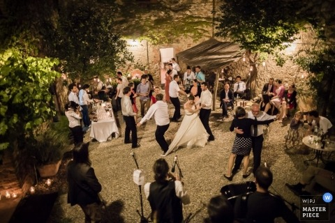 Wedding Photography in Siena Image contains: outdoor, reception, dancing, trees, venue
