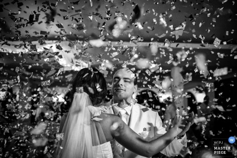 Toronto Wedding Photography | Image contains: first dance, confetti, black, white, couple, indoors, veil