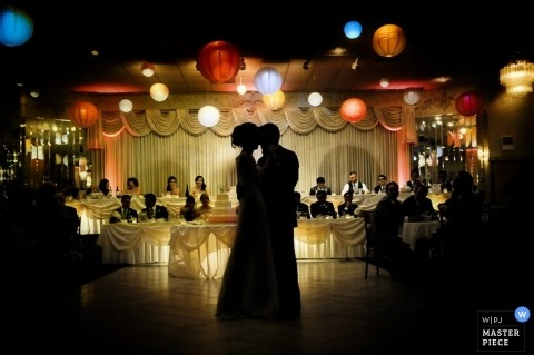 Illinois Wedding Photography | Image contains: reception, first dance, colored lights, silhouette, bride, groom